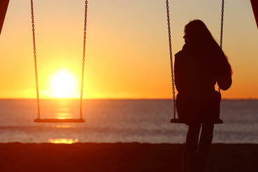 Woman alone on a swing looking at the sunset. Coping with infidelity can be hard for both people in a relationship. Sex therapy in Plymouth, MN can also include couples therapy for infidelity in Plymouth, MN. Online therapy in Minnesota can help you today!